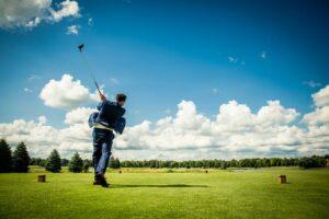 groom golfing wedding photography