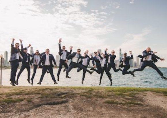 groomsmen-jumping-in-air-in-front-of-detroit-riverfrontjpg