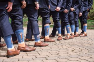 groomsmen showing off socks