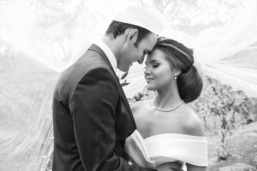 bride and groom flowing veil