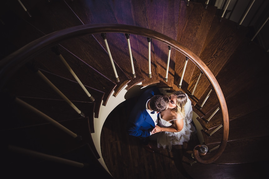 bride and groom spiral staircase
