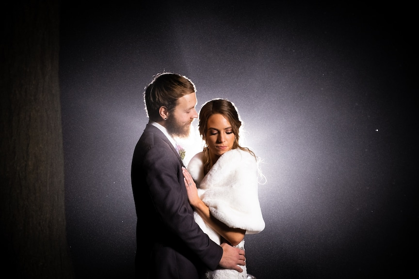 bride and groom with back light