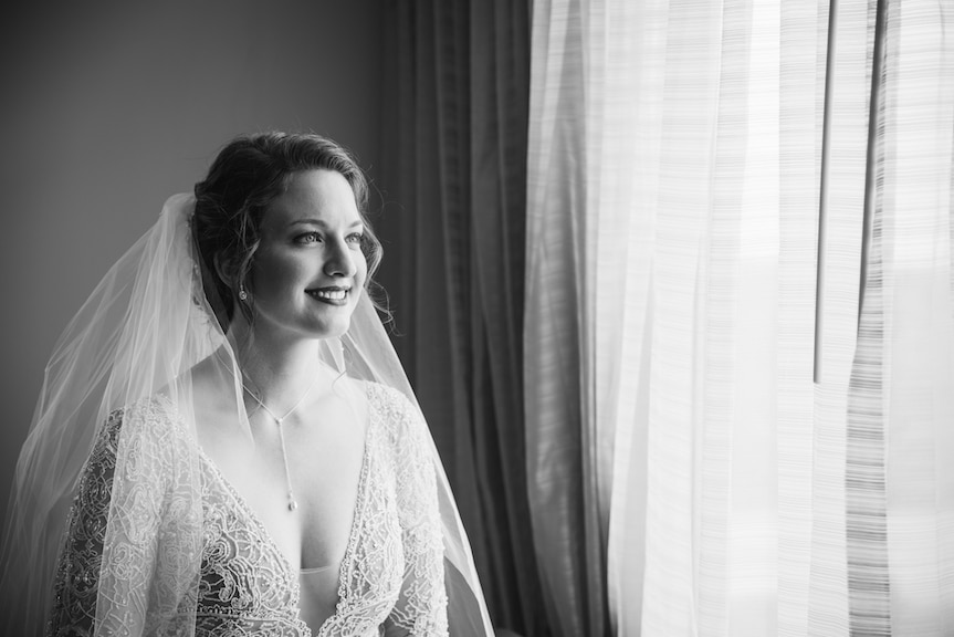 bride preceremony smiling black and white