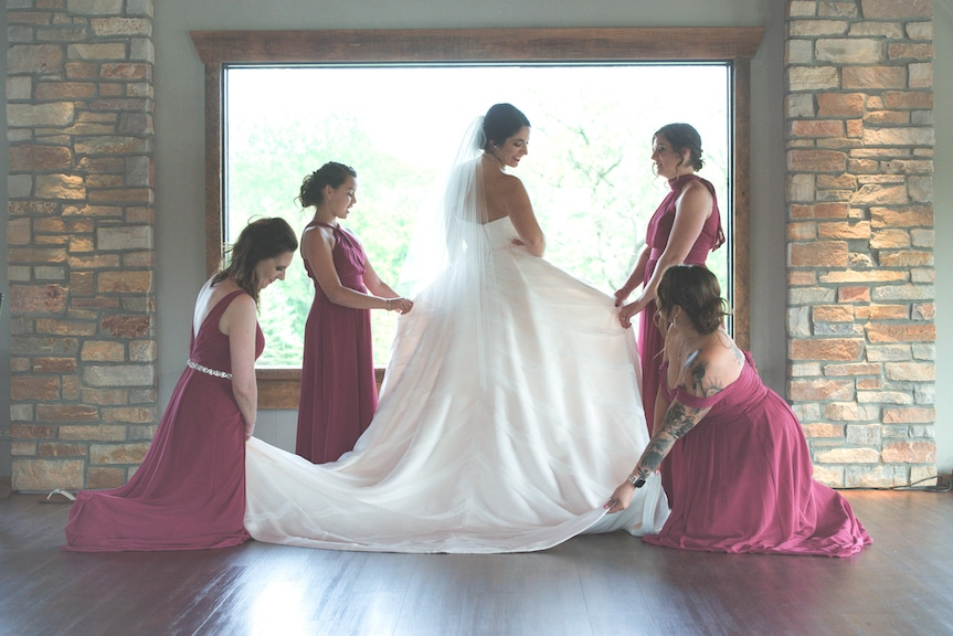 bridesmaids with bride and dress