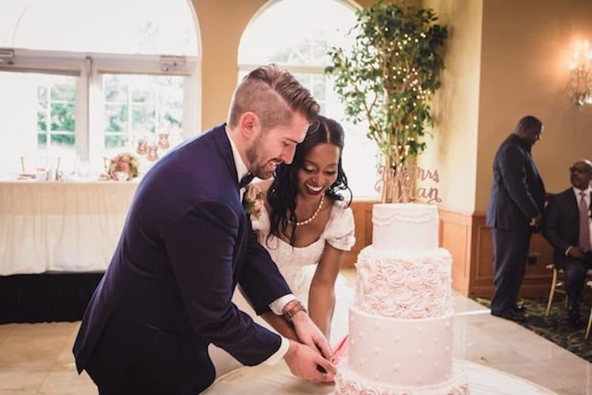 devin and karah cutting cake