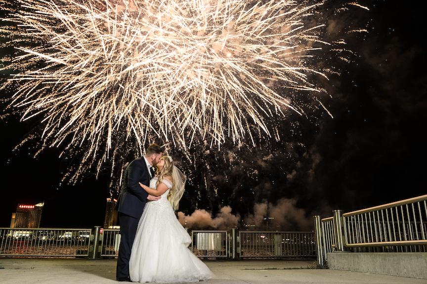 fireworks over bride and groom