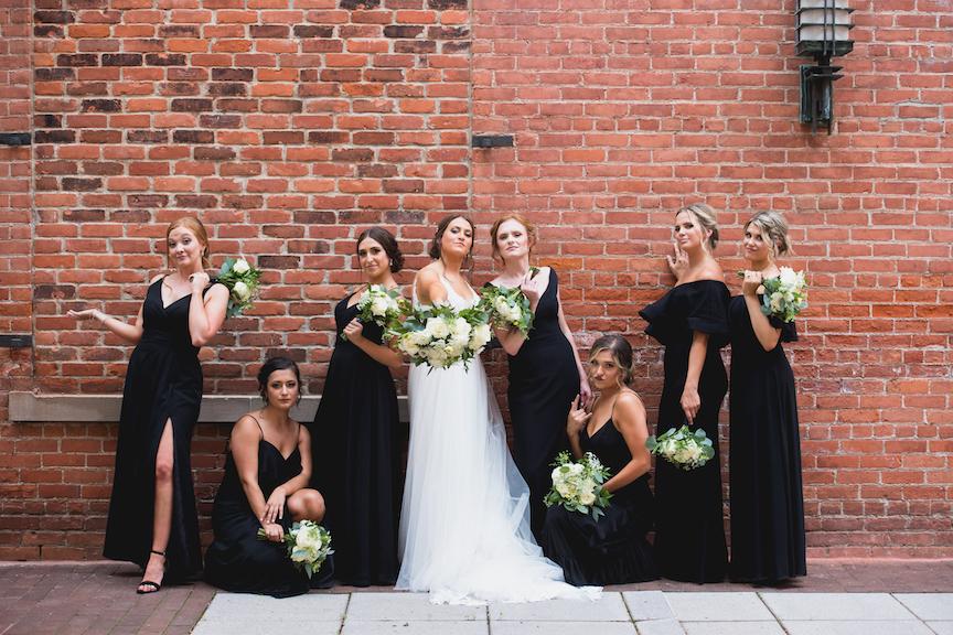 fun bride and bridesmaid brick wall