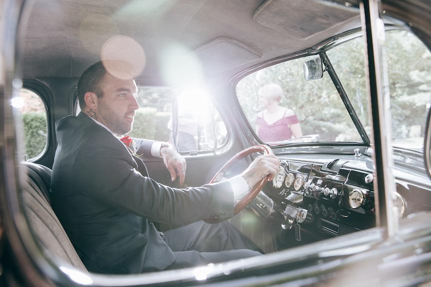 groom in vintage car