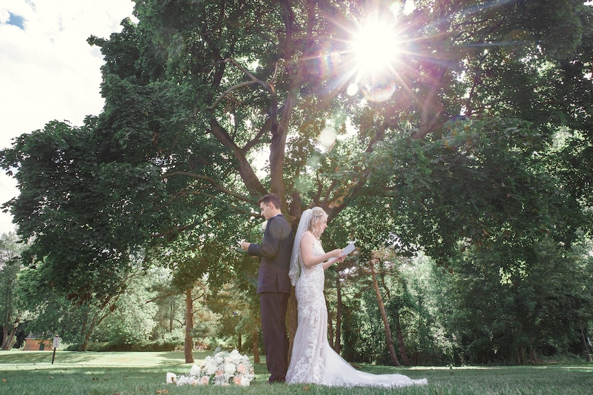 outdoor sun with trees bride and groom