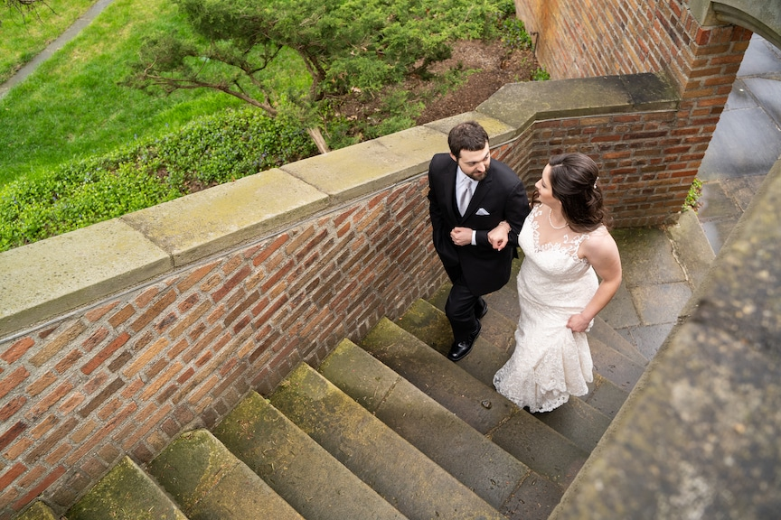 walking up stairs bride and groom
