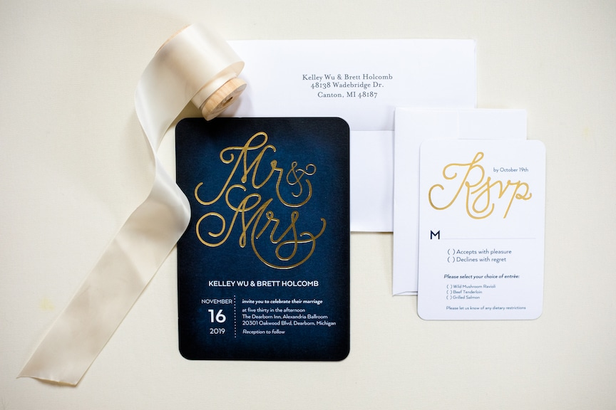 white and navy invitations