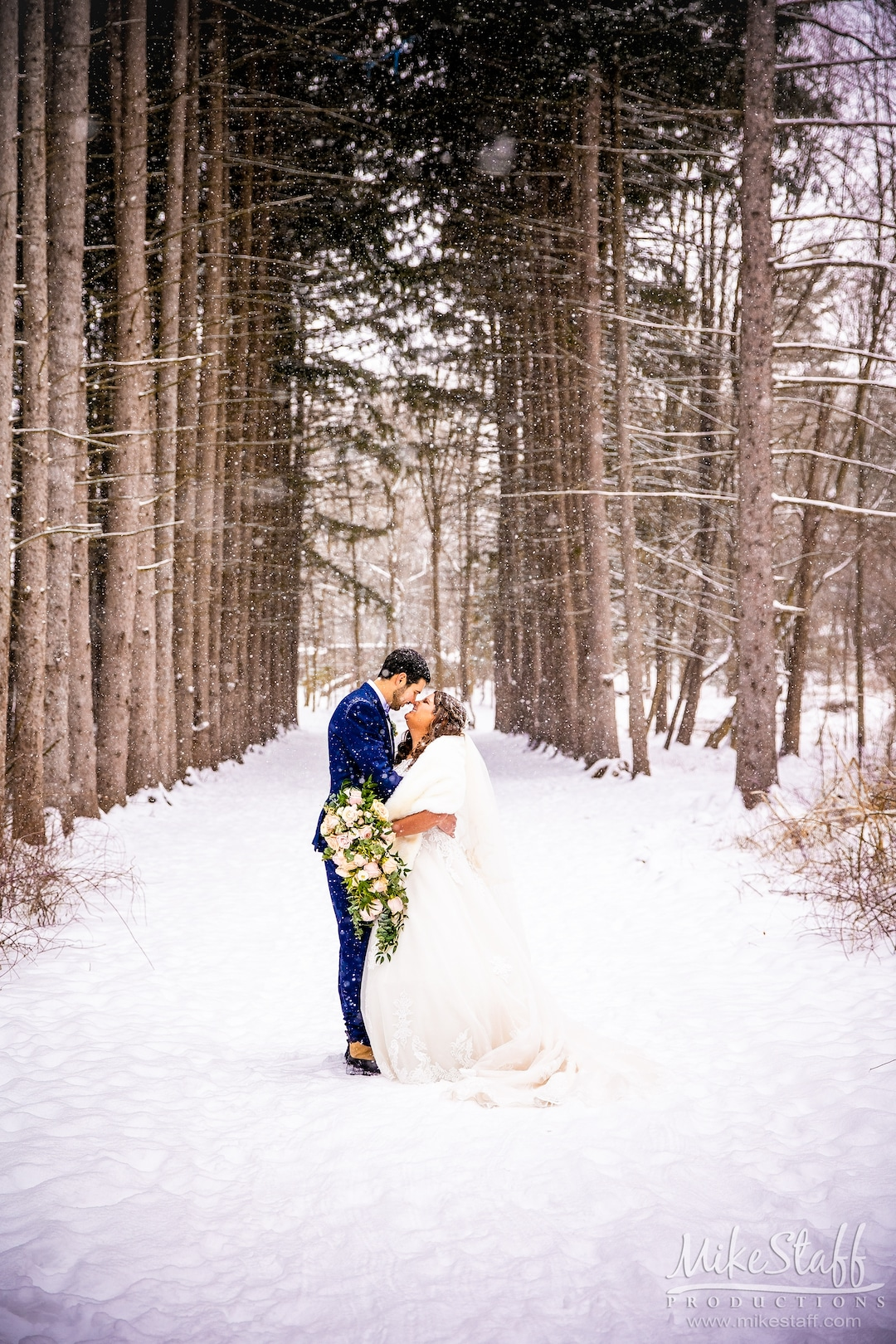 bride and groom outside in snow during winter metro detroit wedding