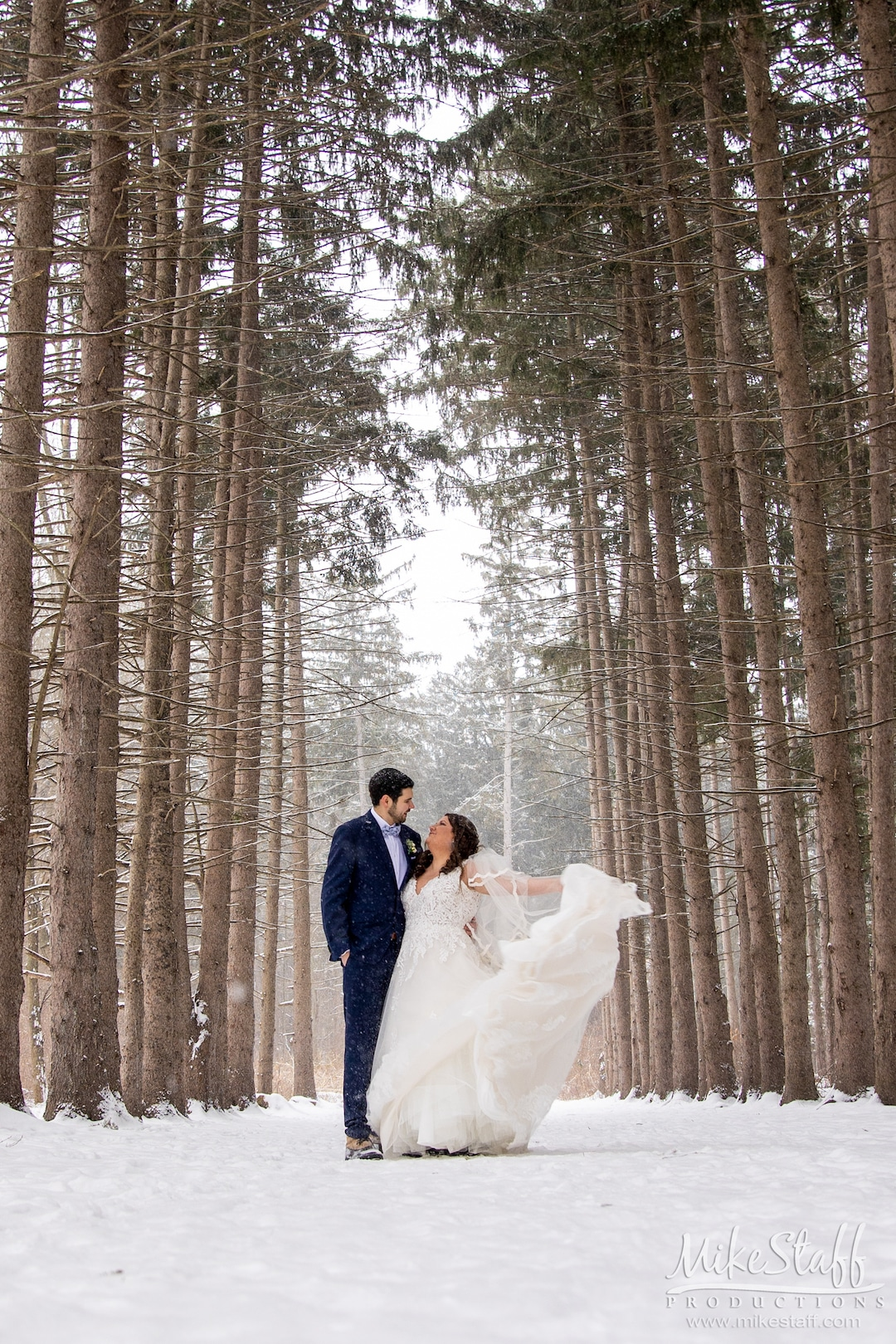 bride and groom outside in winter