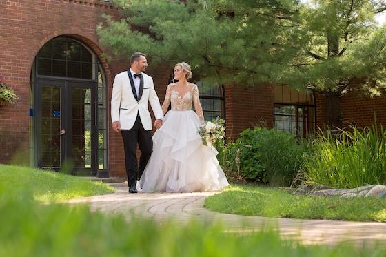 bride alyssa walking with groom inn at st johns