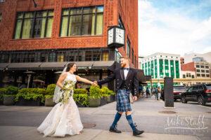 groom in kilt walking with bride downtown detroit